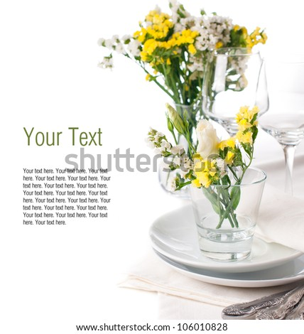 Festive table setting and decoration with fresh yellow flowers - stock photo