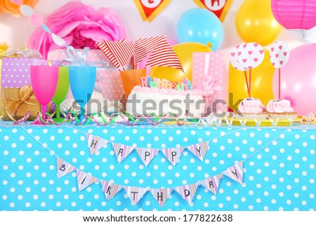 Festive table setting for birthday on celebratory decorations  - stock photo