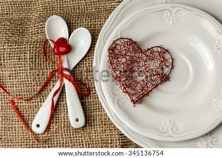 Festive table setting for Valentines Day on light background - stock photo