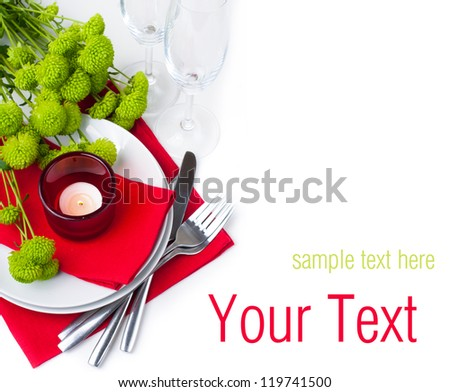 Festive table setting with chrysanthemums, glasses, candles, napkins and cutlery in red and green colors, ready template - stock photo