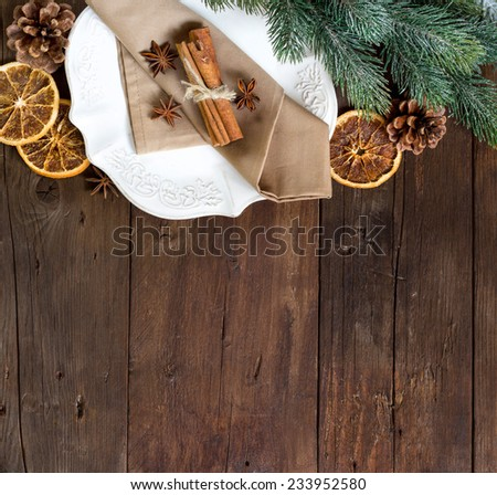 Festive table setting with spices on wooden table - stock photo