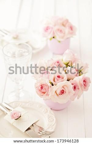 festive wedding table setting - rose flowers in vase - stock photo