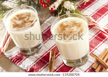 Festive White EggNog with Cinnamon for the Holidays - stock photo