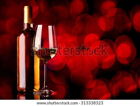 Festive white wine on a red background