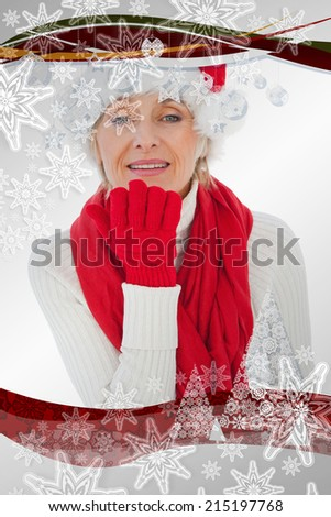 Festive woman blowing a kiss against christmas frame - stock photo