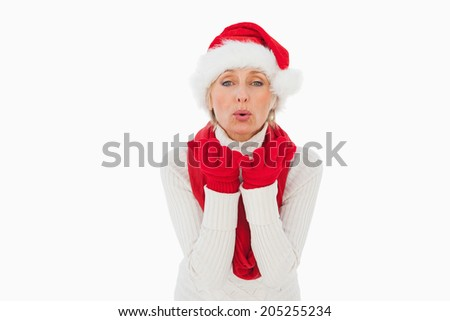 Festive woman blowing a kiss on white background - stock photo