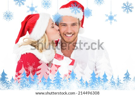 Festive young couple exchanging presents against snowflakes and fir trees - stock photo