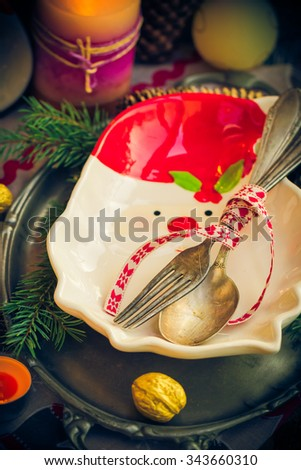 Festively decorated Christmas table: tableware, candles, all in the Christmas mood