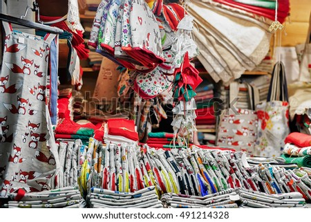 Festively ornamental and handmade linen materials presented for sale at the Christmas market in Riga, Latvia. At the fair people can also buy souvenirs, goods, warm clothes and traditional food.