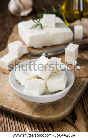 Feta Cheese (on wooden background) as detailed close-up shot - stock photo