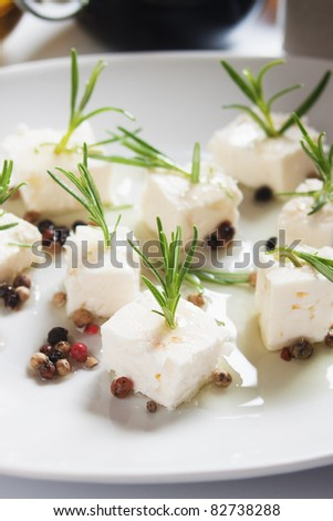 Feta cheese salad with rosemary, peppercorn and olive oil