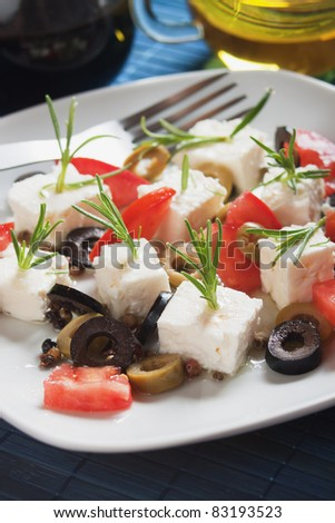 Feta cheese salad with rosemary, tomato and olive