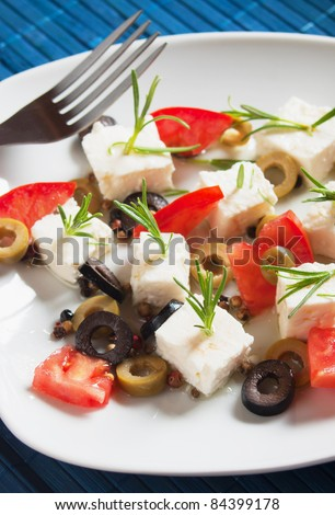 Feta cheese with olive, tomato and rosemary