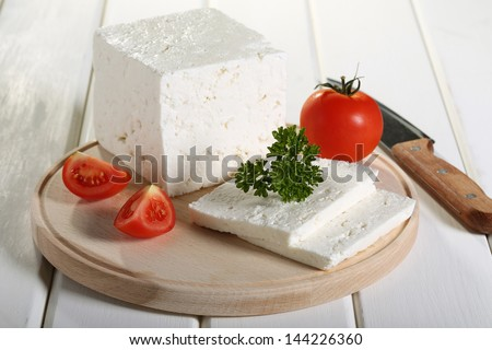 feta greek cheese on chopping board white background