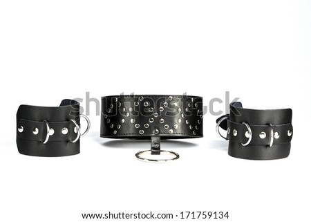 Fetish Hand cuffs and  collar a made of black leather - stock photo