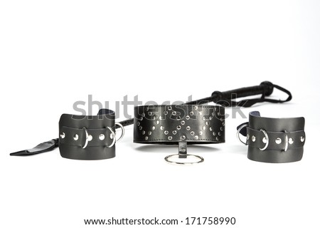 Fetish Hand cuffs, collar and whip made of black leather - stock photo