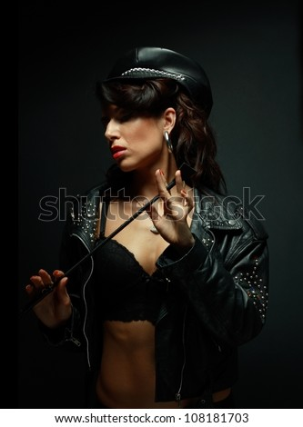 Fetish model in sexy outfit with Strict Leather Short Handle Wide Head Riding Crop