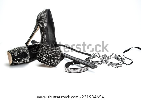 Fetish stuff: mask, whip, collar and high heels - stock photo