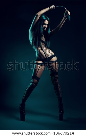 fetish woman with whip in hands - stock photo
