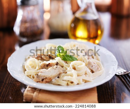 fettuccine alfredo with grilled chicken dinner - stock photo