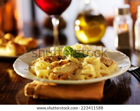 fettuccine alfredo with grilled chicken dinner at night - stock photo