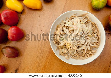 fettuccine alfredo with heirloom tomatoes - stock photo