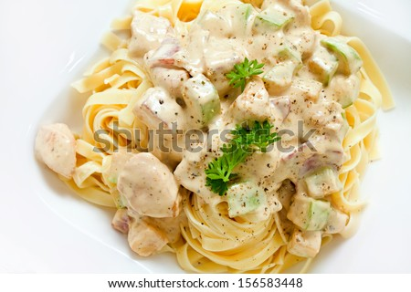 Fettuccine Alfredo with white chicken zucchini sauce with nice copy space. Overhead shot - stock photo
