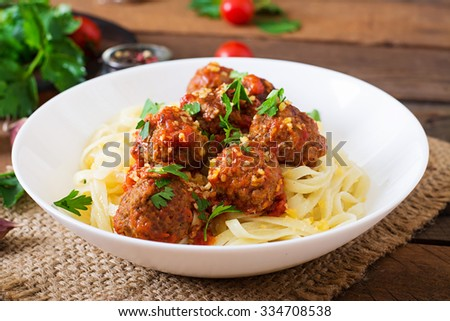 Fettuccine Pasta with meatballs in tomato sauce - stock photo