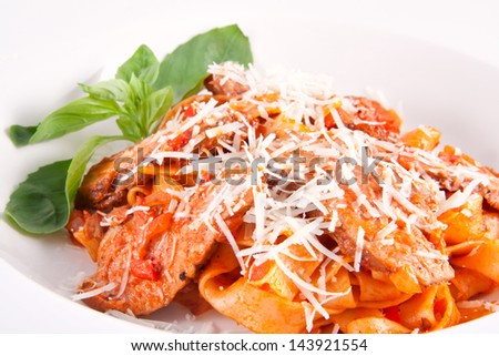 Fettuccine with duck breast - stock photo