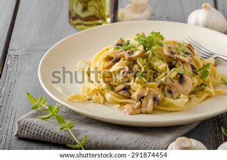 Fettuccine with garlic and mushrooms, olive oil and fresh herbs