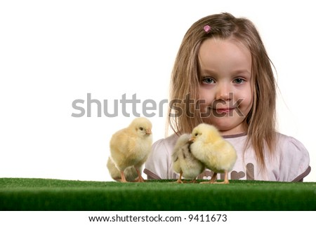 Few baby chickens and five years old girl playing with them over white background - studio shot.