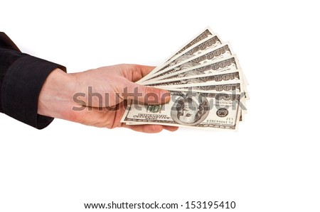 Few bills of U.S. dollars in male hand isolated