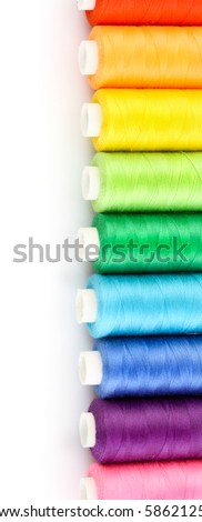 Few bobbins isolated on white - stock photo