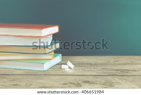 Few books with chalk on table