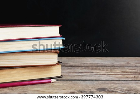 Few books with pencil on table