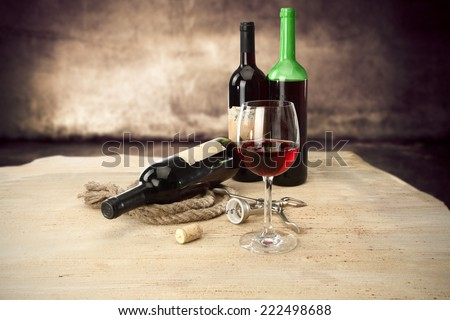 few bottles of wine and glass  - stock photo