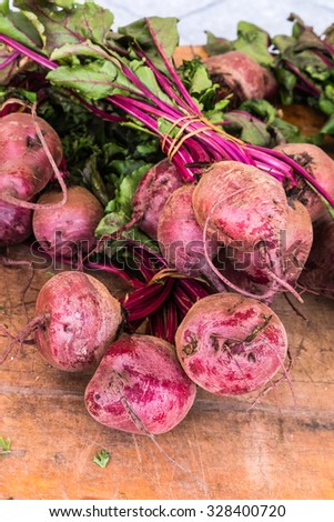 few bunches of beets in a market for sale