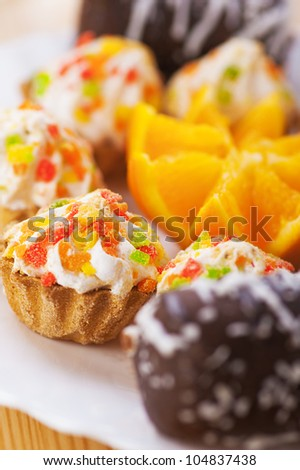 Few cakes on wooden table. - stock photo