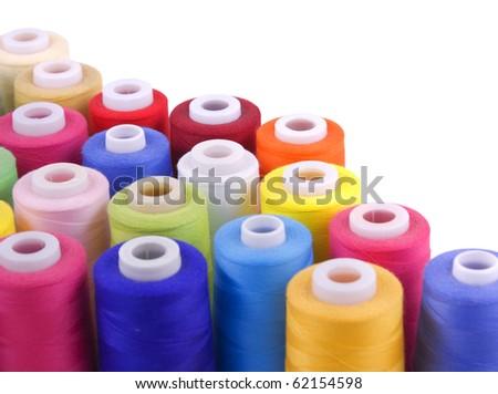 few colorful bobbins isolated on white background - stock photo