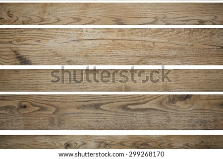 Few cutting wooden light brown colored empty building boards in horizontal position for signs or other advertisement text isolated on white background texture copyspace,  - stock photo