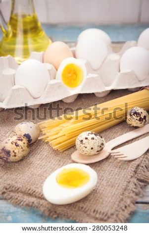 few different eggs with macaron and oil in a studio - stock photo