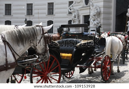 Few empty carriages with horses on street, Vienna,Austria - stock photo