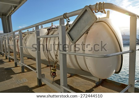 Few inflatable liferafts on the ship. - stock photo
