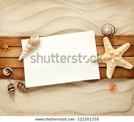 Items Wooden Boards Against Sandy Background Stock Photo