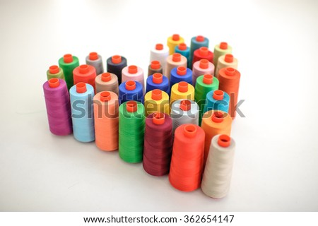 few nice colorful bobbins isolated on white