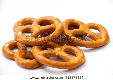 Few pretzels on a white background. - stock photo