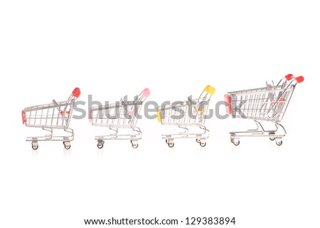 few small metal shopping carts isolated on white