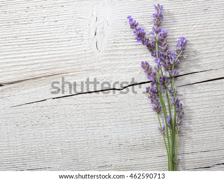 Few sprigs of lavender on an old wooden background