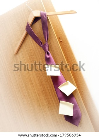 Few sticky notes on a tie as a symbol of planning in business. - stock photo