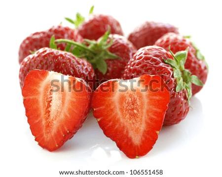 Few strawberries on isolated white background, closeup - stock photo